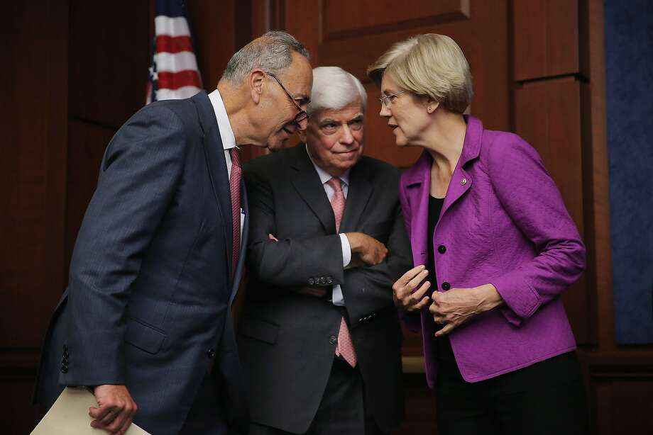 Sens. Chuck Schumer, D-N.Y. (left), and Sen. Elizabeth Warren, D-Mass., talk with former Sen. Chris Dodd in July. Photo: Chip Somodevilla