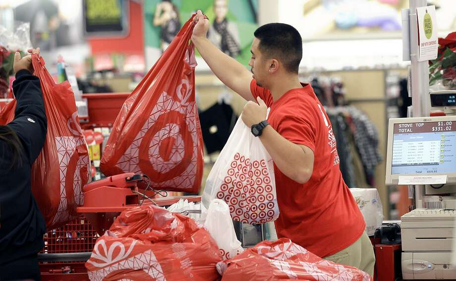 Target stores like this one in Colma are giving free Fitbit activity trackers to employees as the retailer tries to portray itself as a healthier place. Photo: Jeff Chiu, Associated Press