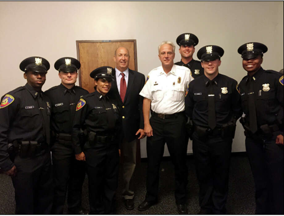 Six police cadets graduated from their training at the Connecticut Police Academy in Meriden on Tuesday. Pictured from left are Kevin Lochard, Steve Orgera, Dilly Santos, Chief Jon Fontneau, Asst. Chief Thomas Wuennemann, Steve Estabrook, Conor Canning and Kelly Reynolds. Photo: Contributed / Contributed Photo / Stamford Advocate  contributed