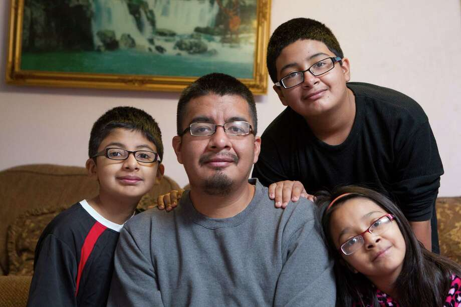 In the future, experts predict there will be more single-parent households like Luis Rivera's, shown here with his children, Angel, 11, left, Luis, 13, and Princess, 10, in their north Houston home. Photo: Johnny Hanson /Houston Chronicle / Houston Chronicle