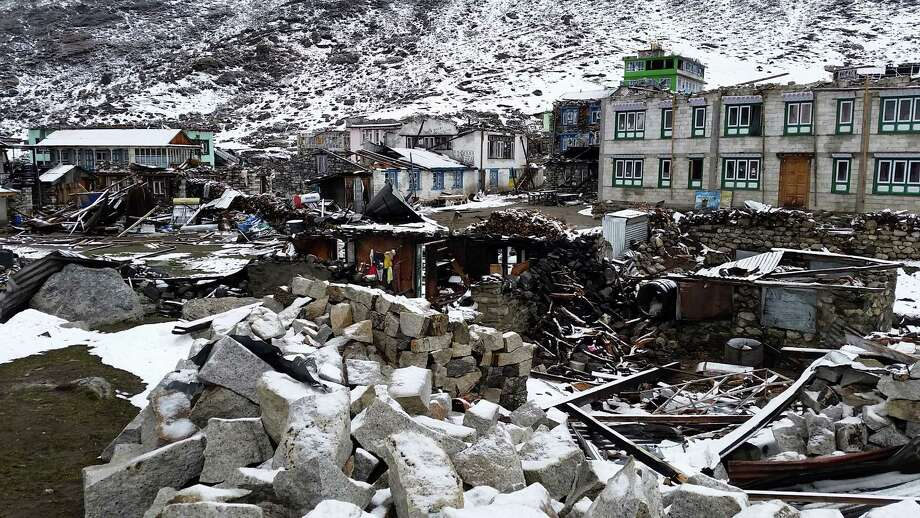 "This undated photo provided by Smithsonian Channel shows the ruins of Kanjin Gompa, a village in the Langtang Valley destroyed by a landslide in a scene from the documentary, ""Nepal Quake: Terror on Everest,"" a one-hour special airing on Monday, June 8, 2015, at 9 p.m. ET. (Kat Heldman/Smithsonian Channel via AP) Photo: Kat Heldman / Associated Press / Smithsonian Channel"