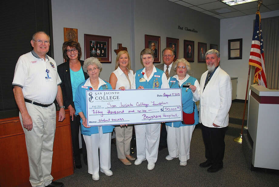 The Bayshore Medical Center volunteer auxiliary is celebrating its 50 years of service this year by giving $50,000 toward San Jacinto College scholarships. Pictured from left to right is John Logan, Bayshore Medical Center volunteer and incoming scholarship chair; Dr. Brenda Hellyer, San Jacinto College Chancellor; Melba Solemsas, Bayshore Medical Center volunteer; Ruth Keenan, executive director of the San Jacinto College Foundation; Cathy Leimback, Bayshore Medical Center volunteer; Larry Wilson, vice chairman of the San Jacinto College Board of Trustees; Miriam Moore, Bayshore Medical Center volunteer; and Michael Kane, dean of health sciences at San Jacinto College. Photo: Amanda Fenwick, San Jacinto Coll