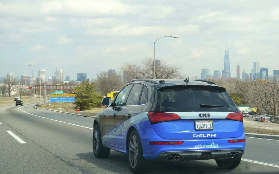 In this Monday, March 30, 2015 photo provided by Delphi Corp., the company's autonomous car approaches New York City, its final destination of a 3,400-mile road trip across the U.S., near Jersey City, N.J. Ninety-nine percent of the time, the car steered itself; only in very tricky situations, like a construction zone, did drivers take control. Now engineers will take the reams of data from the trip and use it to further advance autonomous technology. (AP Photo/Delphi Corp.) Photo: Associated Press File Photo / Delphi
