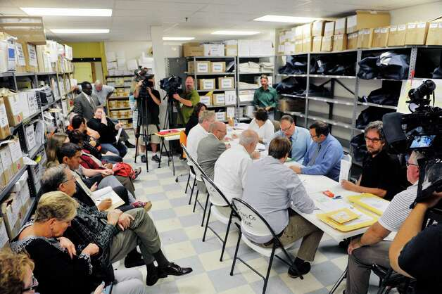 Employees of the Rensselaer County Board of Elections count absentee ballots in the Democratic primary for mayor as candidates and their supporters look on at the Rensselaer County Board of Elections on Wednesday, Sept. 16, 2015,  in Troy, N.Y.   (Paul Buckowski / Times Union) Photo: PAUL BUCKOWSKI / 00033346A