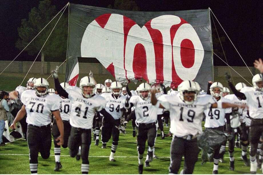 """The Permian High Panthers take to the field in a scene from the 2004 film """"Friday Night Lights."""" Photo: Ralph Nelson /Universal Studios / 2004 UNIVERSAL STUDIOS"""