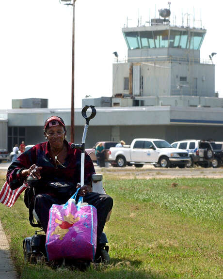 Lilliam Sam moved herself from one part of the Southeast Texas Regional Airport in Port Arthur during a mandatory evacuation ahead of Hurricane Rita on Sept. 22, 2005. Photo: Beaumont Enterprise / © 2005 The Beaumont Enterprise