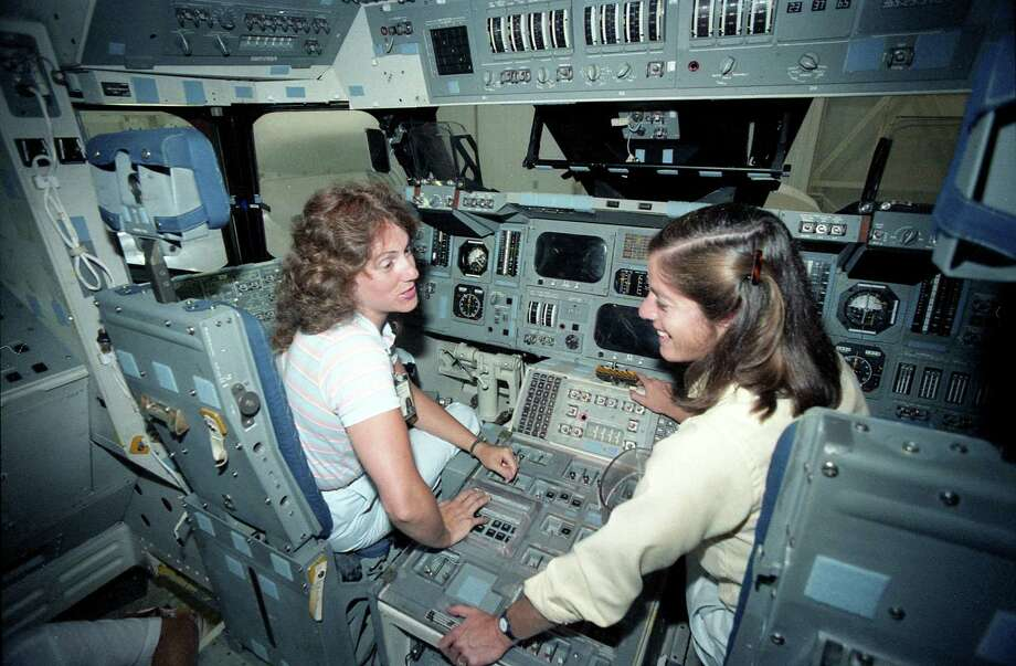 Teacher Christa McAuliffe gets a tour of the space shuttle mockups at the public affairs offices at the Johnson Space Center, Sept. 12, 1985. With her is teacher Barbara Morgan. Photo: John Everett, Houston Chronicle / Houston Chronicle