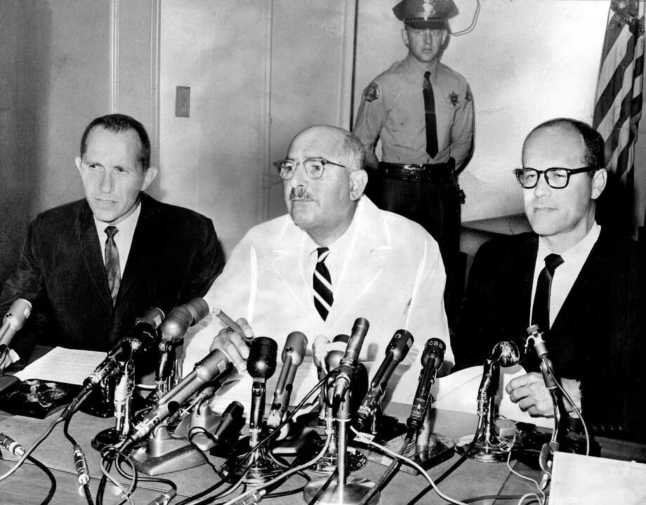 "Norman Farberow, left, L.A. County Coroner Theodore J. Curphey and Dr. Robert Litman at the 1962 news conference announcing that Marilyn Monroe's death was ""a probable suicide."" Farberow, who co-founded the country's first suicide prevention center, has died at age 97. (Los Angeles Times/TNS) Photo: Los Angeles Times, MBR / McClatchy-Tribune News Service / Los Angeles Times"