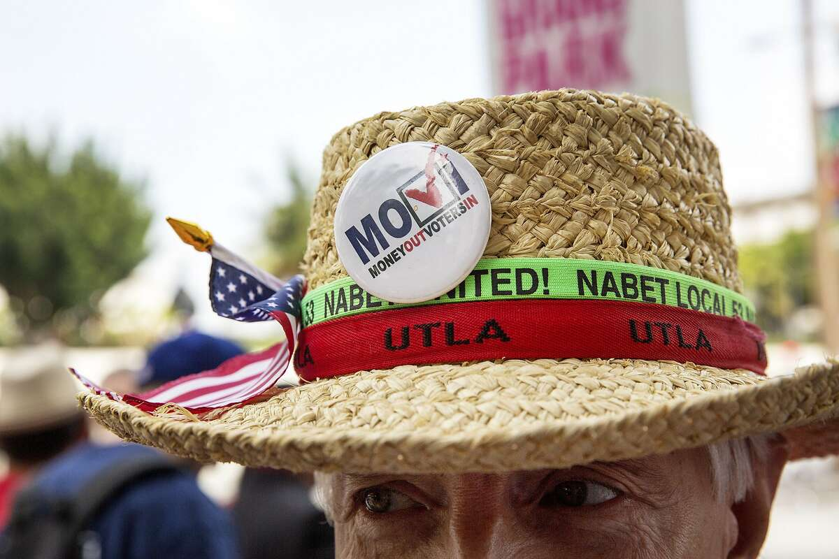 A participant in a protest after a court decision ruled teacher tenure laws unconstitutional, in Los Angeles, June 10, 2014. The landmark ruling by Judge Rolf Treu of Los Angeles County is likely to lead to a flood of copycat suits in other states, shifting the battleground on the issue from the legislatures to the courts. (Monica Almeida/The New York Times)