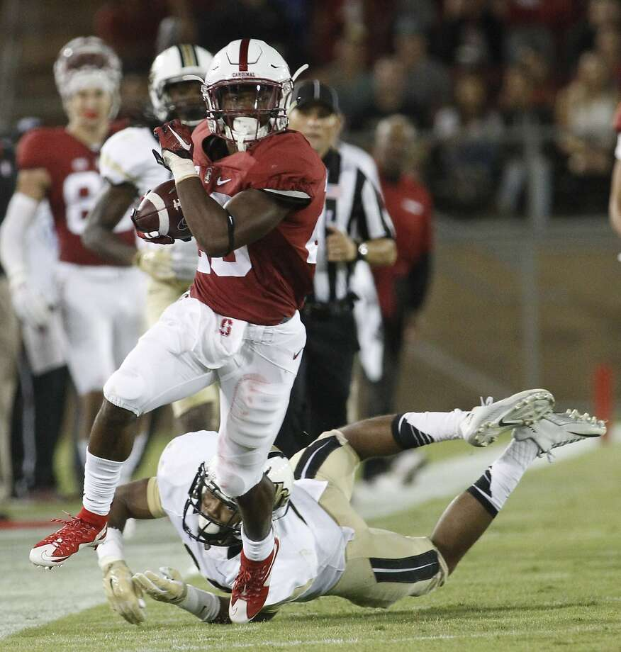 Bryce Love blows by UCF's Tre Neal during an explosive run Saturday night during Stanford's 31-7 victory. Photo: Mathew Sumner, Associated Press