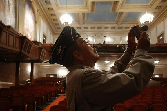 Veteran Joe Chan, American Legion Cafe Post 384, takes pictures at the historic War Memorial Veterans building after it was re-dedicated in a ceremony in San Francisco, Calif., on Wednesday, September 16, 2015.