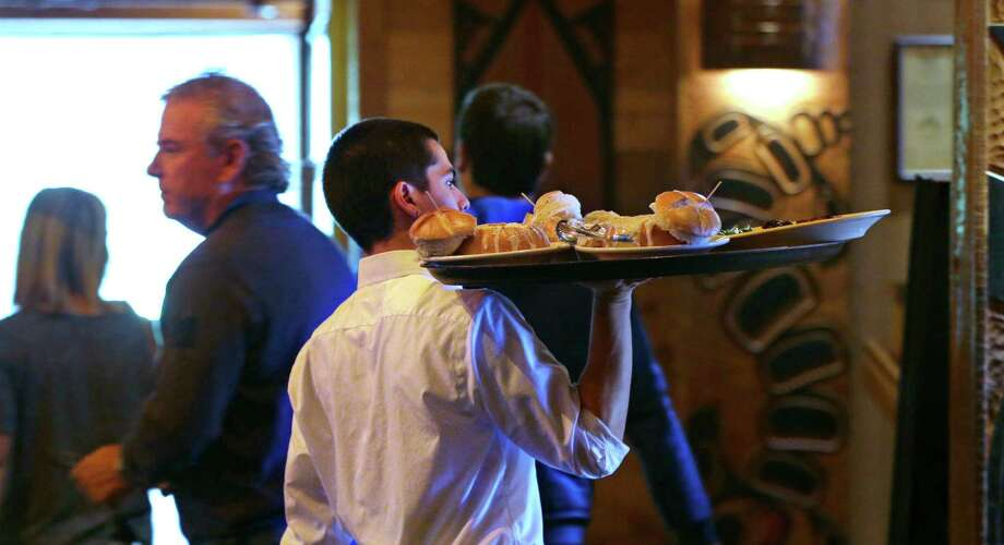 Many restaurant chains are already at work looking for ways to take humans out of the picture, threatening workers in an industry that employs 2.4 million wait staffers, nearly 3 million cooks and food preparers and many of the nation's 3.3 million cashiers. Not everybody, however, agrees that machines could make that much of a dent in labor costs. Photo: Elaine Thompson /Associated Press / AP