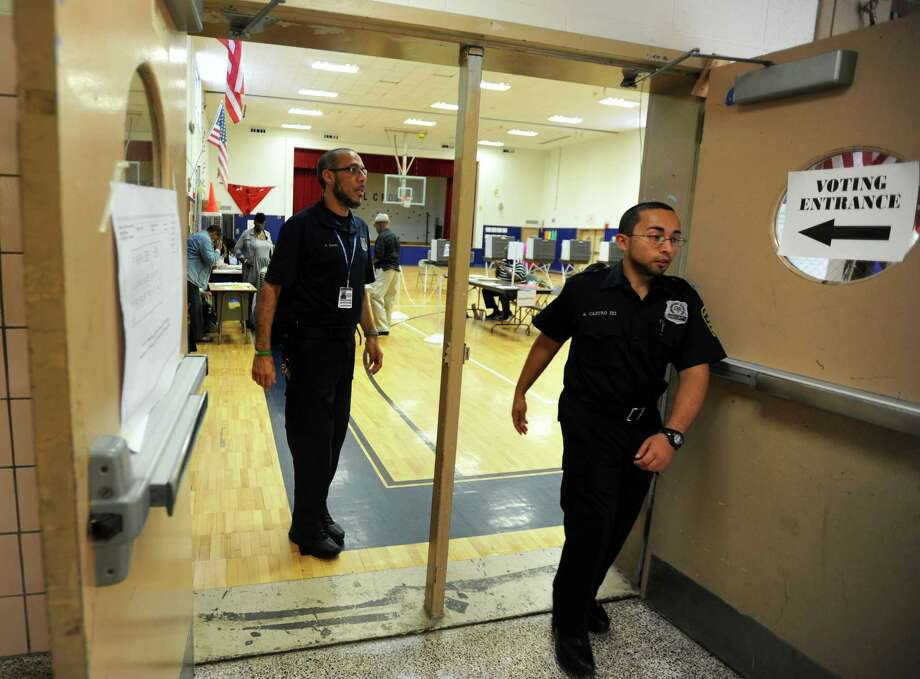 "School security officers enforce a ""lock in, lock out"" at Wilbur Cross School in Bridgeport, Conn., Wednesday, Sept. 16, 2015, during voting for the primary election. The schools was locked down for a brief period of time, no one was allowed to leave or enter, following reports of shots fired in the area. Photo: Autumn Driscoll / Hearst Connecticut Media / Connecticut Post"