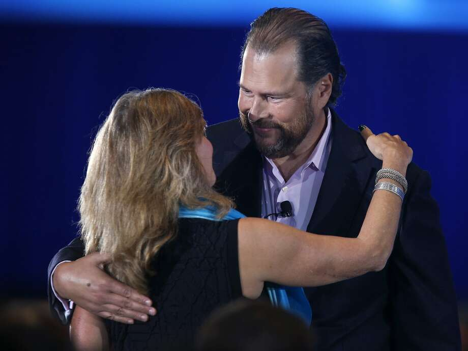 Salesforce CEO Marc Benioff hugs Athena Breast Health Network founder Dr. Laura Esserman during his keynote speech at the annual Dreamforce conference at Moscone Center in San Francisco, Calif. on Wednesday, Sept. 16, 2015. Photo: Paul Chinn, The Chronicle