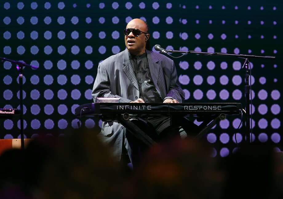 Stevie Wonder performs on stage before introducing Salesforce CEO Marc Benioff, who delivered the keynote speech, at the annual Dreamforce conference at Moscone Center in San Francisco, Calif. on Wednesday, Sept. 16, 2015. Photo: Paul Chinn, The Chronicle