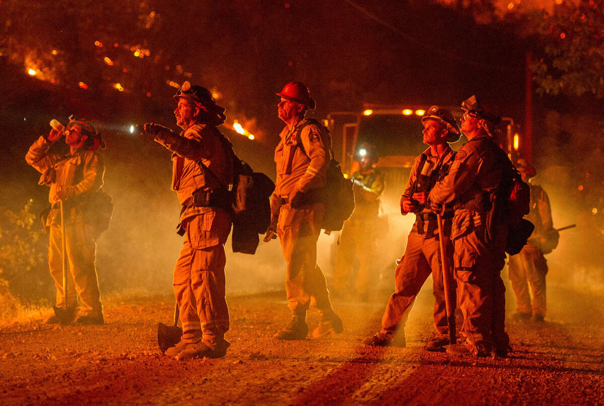 Firefighters monitor a backfire while battling the Butte fire near San Andreas, California on September 12, 2015. According to state fire agency CAL FIRE, the fire has burned more than 65,000 acres and 86 homes.