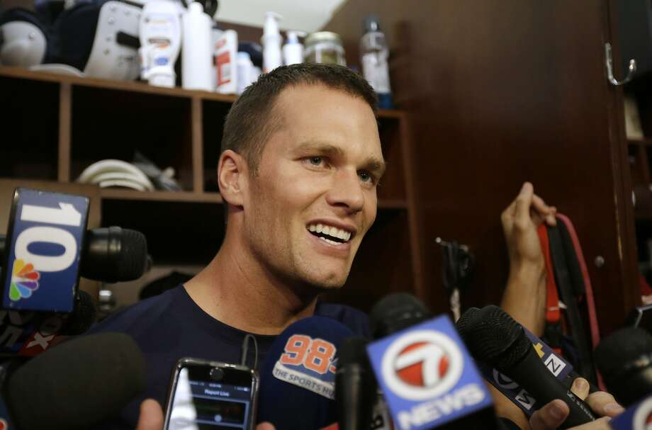 New England Patriots quarterback Tom Brady speaks with members of the media in the locker room before an NFL football practice, Wednesday, Sept. 16, 2015, at Gillette Stadium, in Foxborough, Mass. (AP Photo/Steven Senne) Photo: Steven Senne, Associated Press