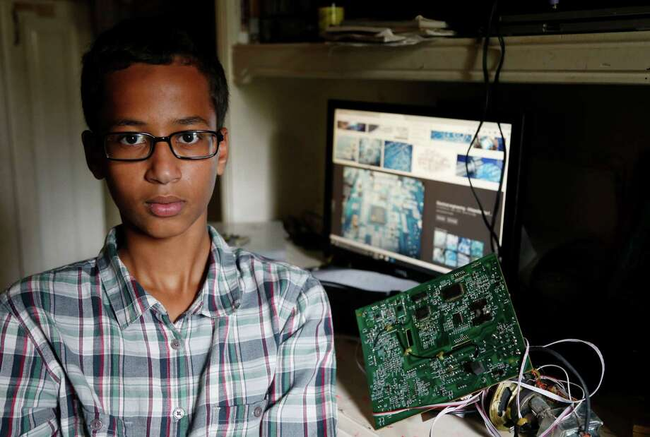 Irving MacArthur High School student Ahmed Mohamed, 14, poses for a photo at his home in Irving, Texas on Tuesday, Sept.  15, 2015. Mohamed was arrested and interrogated by Irving Police officers on Monday after bringing a homemade clock to school. Police don't believe the device is dangerous, but say it could be mistaken for a fake explosive. He was suspended from school for three days, but he has not been charged. (Vernon Bryant/The Dallas Morning News via AP) MANDATORY CREDIT; MAGS OUT; TV OUT; INTERNET USE BY AP MEMBERS ONLY; NO SALES Photo: Vernon Bryant, MBR / Associated Press / The Dallas Morning News