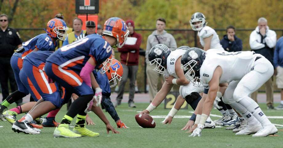Photos from the Staples and Danbury High School boys football game on Saturday, October, 18, 2014, in Danbury, Conn. Photo: H John Voorhees III / H John Voorhees III / The News-Times Staff Photographer