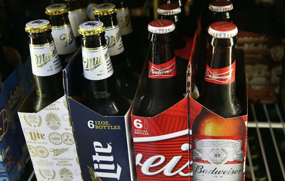 MIAMI, FL - SEPTEMBER 16:  In this photo illustration, bottles of Budweiser and Miller Lite beer are seen on September 16, 2015 in Miami, Florida. Belgium's Anheuser-Busch InBev, which owns Budweiser and is the worlds largest brewer, is reported to be in takeover talks for the number two positioned British-based SABMiller, owner the Miller beers.  (Photo Illustration by Joe Raedle/Getty Images) ORG XMIT: 578727031 Photo: Joe Raedle / 2015 Getty Images