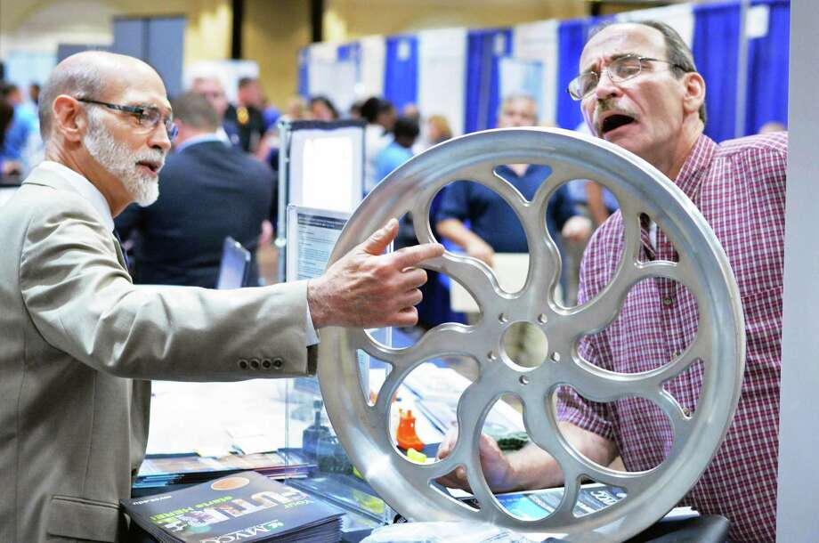 Mohawk Valley Community College professor Robert Decker, left, discusses CNC machining with Jeff Grune of New Lebanon during the Times Union Job Fair at the Albany Marriott Wednesday Sept. 16, 2015 in Colonie, NY.  (John Carl D'Annibale / Times Union) Photo: John Carl D'Annibale / 00033287A