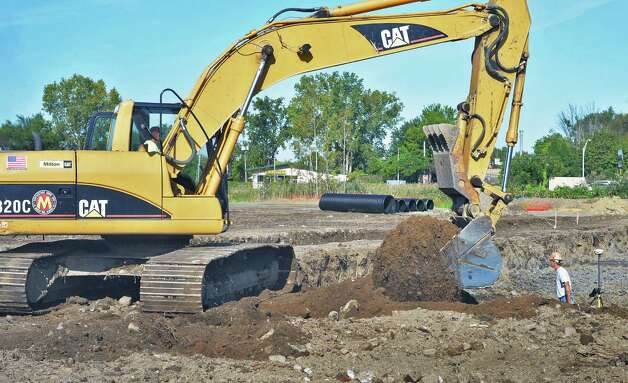 Work has begun on the future 60,000-square-foot headquarters of Pioneer Bank at Wolf and Albany Shaker Roads Wednesday Sept. 16, 2015 in Colonie, NY.  (John Carl D'Annibale / Times Union) Photo: John Carl D'Annibale / 00033382A