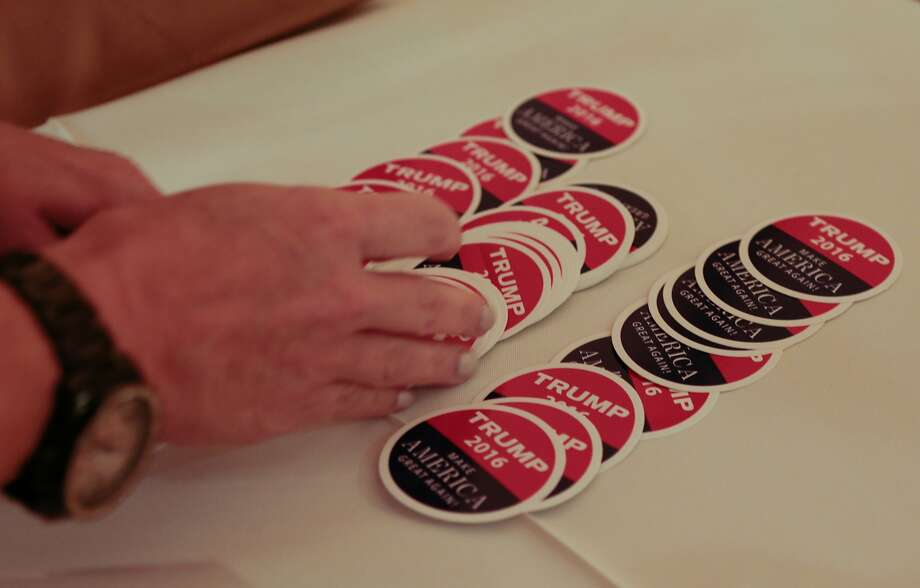 Rachel Pozzi, member of The Nob Hill Republican Women's Club, places Trump 2016 stickers on an information table on Wednesday, Sept. 16, 2015 in San Francisco, Calif.   The Nob Hill Republican Women's Club hosts a debate watch party at the Italian Athletic Club in North Beach. Photo: Nathaniel Y. Downes, The Chronicle