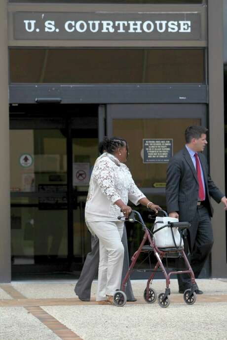 Cornelia V. Hurling, 58, a nurse appointed by the VA to administer the financial affairs of veterans who were deemed incompetent or unfit to do it themselves, leaves the federal courthouse with the assistance of a walker Wednesday Sept. 16, 2015, after pleading guilty to stealing more than $141,000 from those veterans' benefits. Photo: William Luther, Staff / San Antonio Express-News / © 2015 San Antonio Express-News
