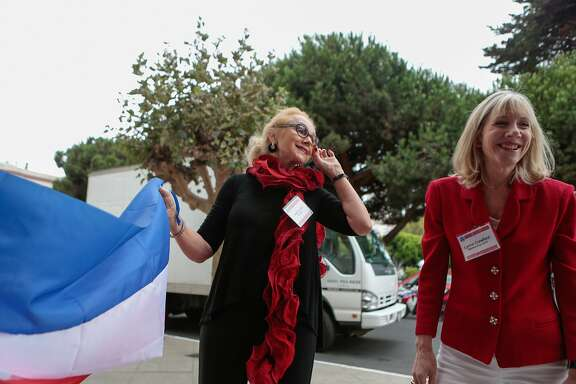 Joan Leone (left), president of The Nob Hill Republican Women's Club, and Lynne Crawford hang decorations for the debate watch party at the Italian Athletic Club in North Beach on Wednesday, Sept. 16, 2015 in San Francisco, Calif.