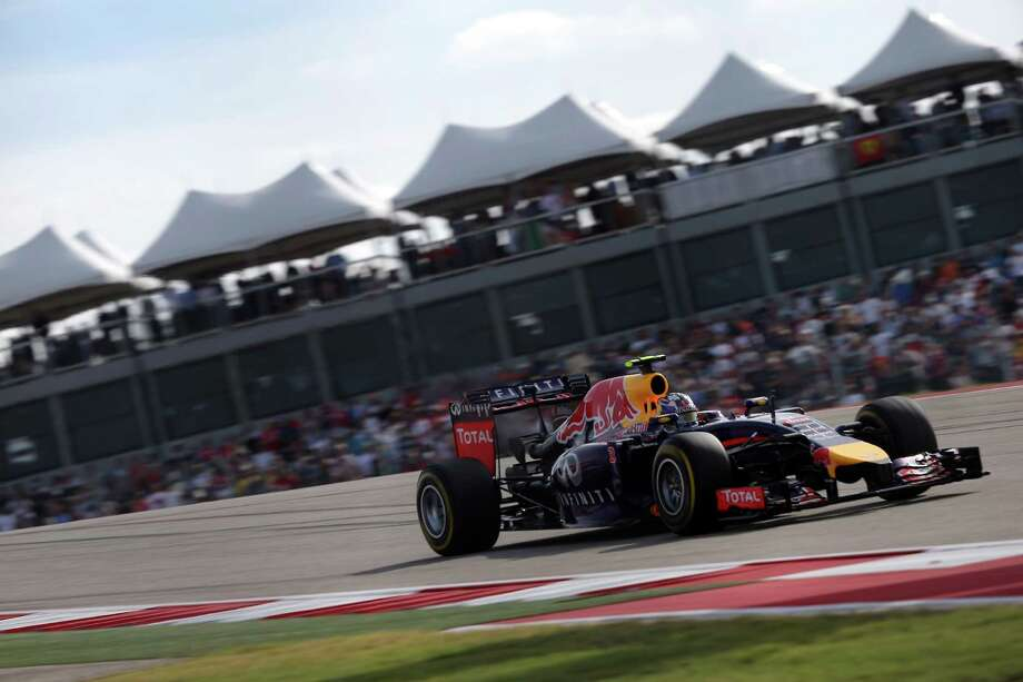 Infiniti Red Bull Racing driver Daniel Ricciardo, 3, makes his way past throngs of fans at the 2014 Formula 1 U.S. Grand Prix in Austin. The Grand Prix has received more than $86 million in local and state funding under the major events fund since 2012. Photo: Michel Fortier /San Antonio Express-News / San Antonio Express-News