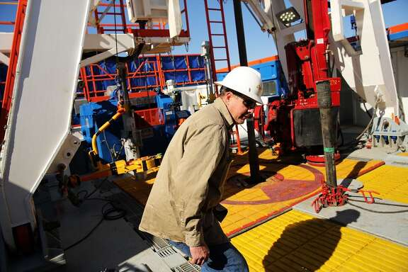 MENTONE, TX - FEBRUARY 05:  A worker with Apache Corp. is viewed at the Patterson 298 natural gas fueled drilling rig on land in the Permian Basin on February 5, 2015 in Mentone, Texas. The rig, which is only 21 days old, is the first  drilling rig in Texas that is 100-percent fueled by natural gas. As crude oil prices have fallen nearly 60 percent globally, many American communities that became dependent on oil revenue are preparing for hard times. Texas, which benefited from hydraulic fracturing and the shale drilling revolution, tripled its production of oil in the last five years. The Texan economy saw hundreds of billions of dollars come into the state before the global plunge in prices. Across the state drilling budgets are being slashed and companies are notifying workers of upcoming layoffs. According to federal labor statistics, around 300,000 people work in the Texas oil and gas industry, 50 percent more than four years ago.  (Photo by Spencer Platt/Getty Images)