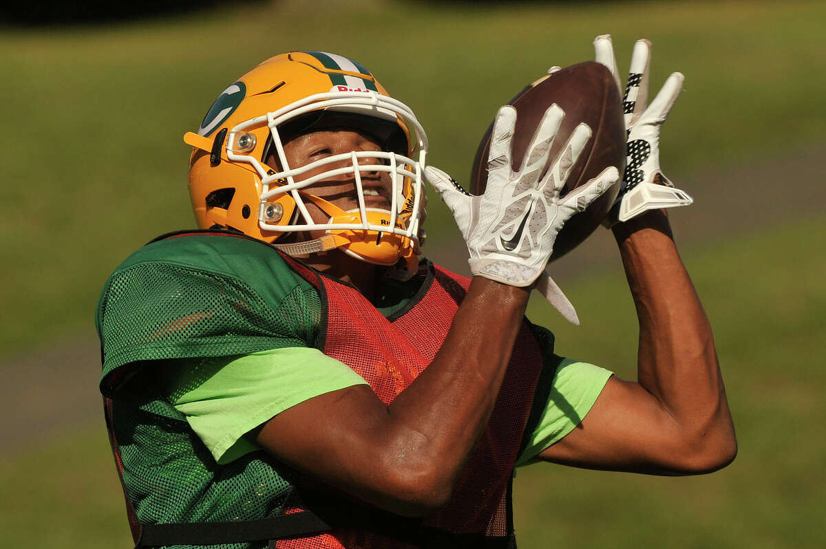 Wide receiver Izaiah Sanders makes a catch during football practice at Trinity Catholic High School in Stamford, Conn., on Wednesday, Sept. 16, 2015.