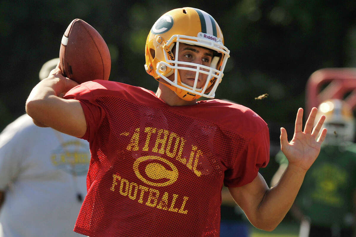 Captain and quarterback Anthony Lombardi throws the ball during football practice at Trinity Catholic High School in Stamford, Conn., on Wednesday, Sept. 16, 2015.