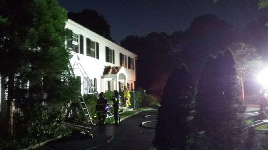 Greenwich firefighters knocked down Wednesday evening a working fire at a home on Londonderry Drive, near the Merritt Parkway. Photo: Contributed