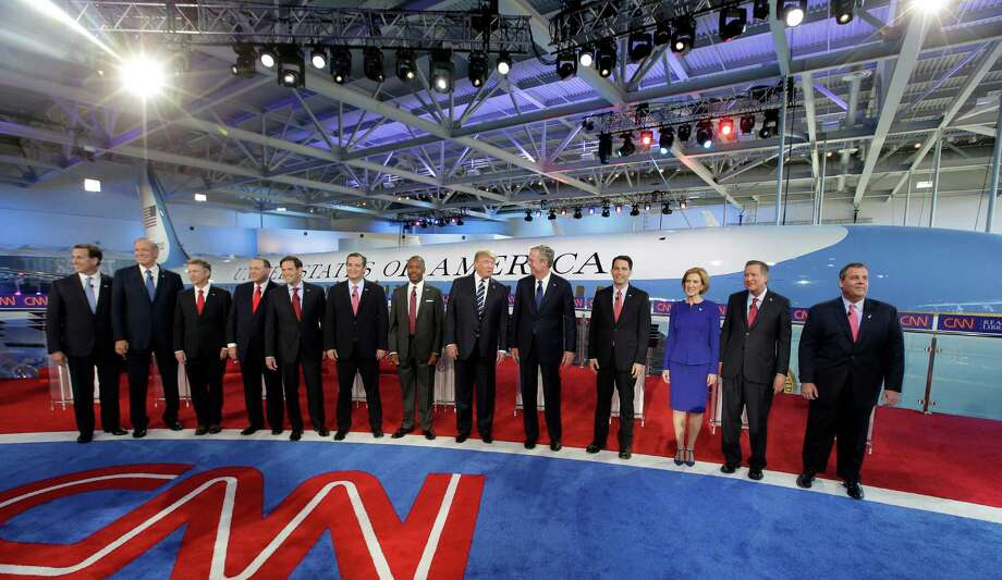 Republican presidential candidates, from left, former Pennsylvania Sen. Rick Santorum, former New York Gov. George Pataki,  Sen. Rand Paul, R-Ky., former Arkansas Gov. Mike Huckabee, Sen. Marco Rubio, R-Fla., Sen. Ted Cruz, R-Texas, retired neurosurgeon Ben Carson, businessman Donald Trump, former Florida Gov. Jeb Bush, Wisconsin Gov. Scott Walker, businesswoman Carly Fiorina, Ohio Gov. John Kasich, and New Jersey Gov. Chris Christie take the stage during the CNN Republican presidential debate at the Ronald Reagan Presidential Library and Museum on Wednesday, Sept. 16, 2015, in Simi Valley, Calif. (AP Photo/Chris Carlson) Photo: Chris Carlson, Associated Press / AP