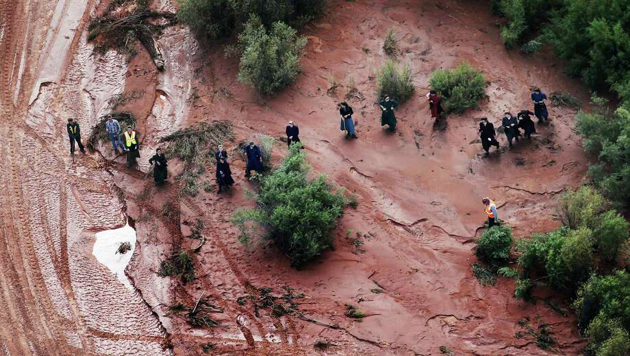 In this aerial photo searchers continue looking for 6-year-old Tyson Lucas Black in Zion National Park, Utah, Wednesday, Sept. 16, 2015. Multiple hikers who entered a narrow desert canyon for a day of canyoneering became trapped when a flash flood filled the chasm with water, killing several of them in Zion National Park in southern Utah, officials said Wednesday. (Scott G Winterton/The Deseret News via AP)  SALT LAKE TRIBUNE OUT; MAGS OUT; NO SALES; MANDATORY CREDIT ORG XMIT: UTSAL104 Photo: Scott G Winterton / The Deseret News