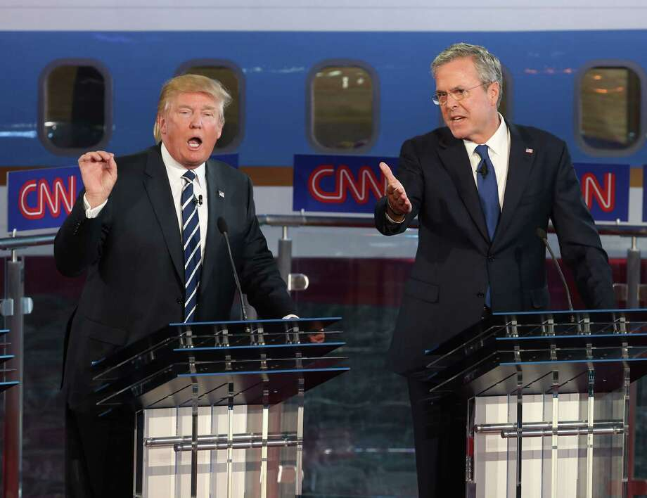 Jeb Bush, right, had to come to the defense of his brother, former President George W. Bush, after Donald Trump criticized him during the Republican presidential debates. Photo: Justin Sullivan, Getty Images / 2015 Getty Images