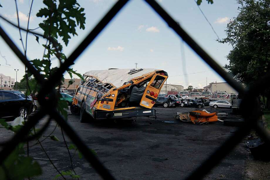 A national debate over seat belts was reignited after this Houston Independent School District bus crashed, resulting in the death of two students. Photo: James Nielsen, Staff / © 2015  Houston Chronicle