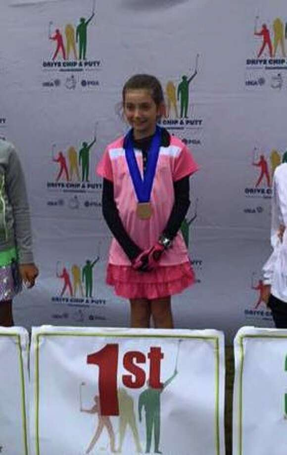 Nicole Criscone, a 9-year-old from Clifton Park, displays her first-place medai Sunday, Sept. 13, after winning the Brookline, Mass., regional of the Drive, Chip and Putt contest. Criscone will compete in the finals next April at the Augusta National Golf Club. (Photo by Tammy Criscone)