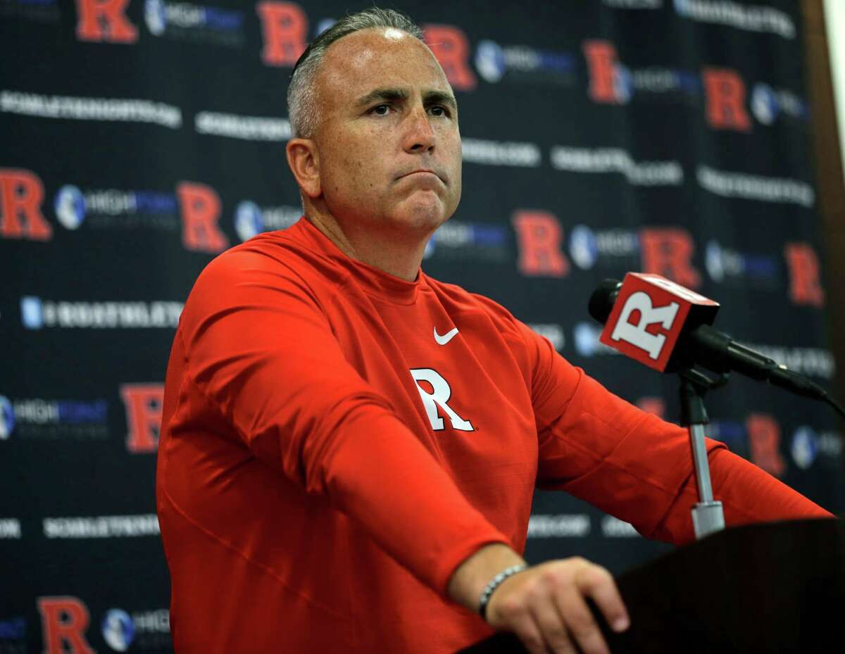FILE - In this Saturday, Sept. 5, 2015 file photo, Rutgers head coach Kyle Flood listens to a question as he addresses the media after his team defeated Norfolk State, 63-13 in an NCAA college football game in Piscataway, N.J. Rutgers has suspended football coach Kyle Flood for three games after he contacted a faculty member over a player?'s status. Rutgers President Robert Barchi announced the punishment Wednesday afternoon, Sept. 16, 2015, a day after he said he received an internal investigative report. (AP Photo/Mel Evans, File) ORG XMIT: NY156