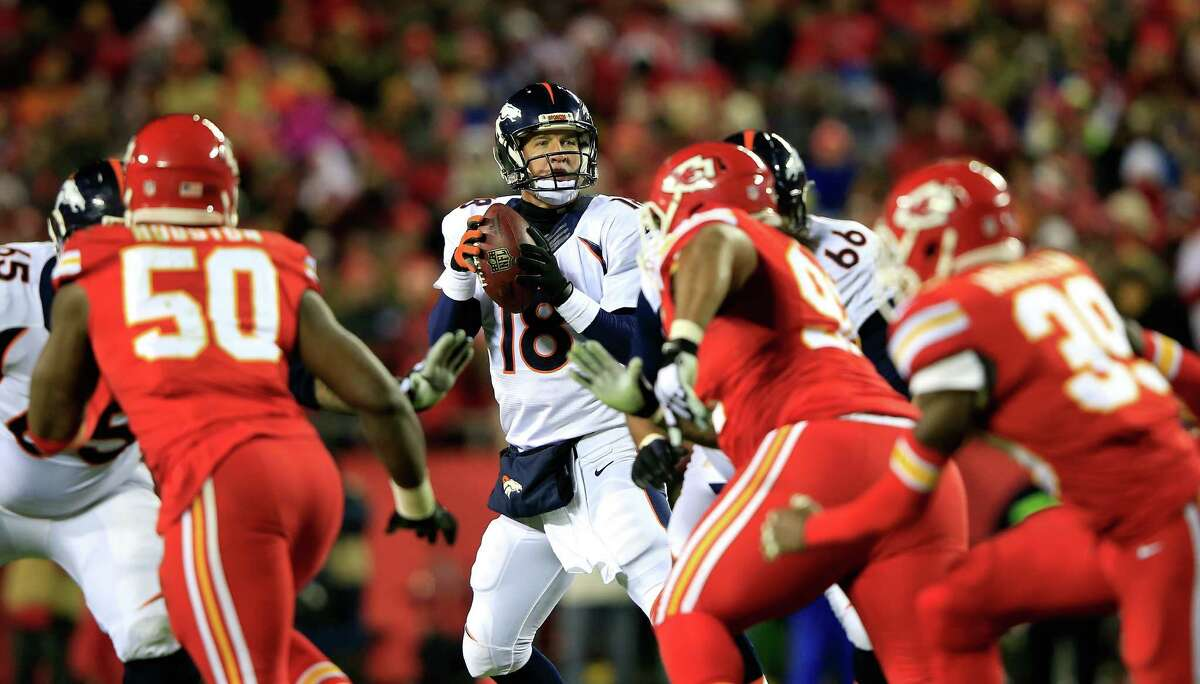 KANSAS CITY, MO - NOVEMBER 30: Peyton Manning #18 of the Denver Broncos looks to pass against the Kansas City Chiefs during the first half at Arrowhead Stadium on November 30, 2014 in Kansas City, Missouri. (Photo by Jamie Squire/Getty Images) ORG XMIT: 507865799