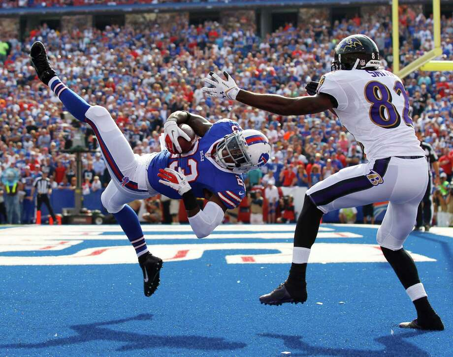 "File-This Sept. 29, 2013, file photo shows Buffalo Bills free safety Aaron Williams (23) intercepting a pass intended for Baltimore Ravens wide receiver Torrey Smith (82) during the second half of an NFL football game in Orchard Park, N.Y. Going on his fourth year in Buffalo, Williams is all too familiar with the cycle of emotions Bills players and fans endure during a season. ""Every year, everybody gets hyped up for an incredible season and then people get let down with a six-win season,"" Williams said, upon reporting for the start of camp. ""To me, I'm getting tired of it.""  (AP Photo/Bill Wippert, File) ORG XMIT: NY152 Photo: Bill Wippert / FR170745 AP"