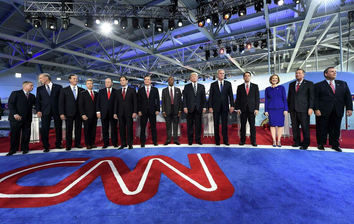 Republican presidential hopefuls, (L-R) South Carolina Sen. Lindsay Graham, former New York Gov. George Pataki, Sen. Rick Santorum, Kentucky Sen. Rand Paul, former Arkansas Gov. Mike Huckabee, Florida Sen. Marco Rubio, Texas Sen. Ted Cruz, retired neurosurgeon Ben Carson, real estate magnate Donald Trump, former Florida Gov. Jeb Bush, Wisconsin Gov. Scott Walker, former CEO Carly Fiorina, Ohio Gov. John Kasich, and New Jersey Gov. Chris Christie, arrive on stage for the Republican presidential debate at the Ronald Reagan Presidential Library in Simi Valley, California on September 16, 2015. Republican presidential candidates collectively turned their sights on frontrunner Donald Trump at the party's second debate, taking aim at his lack of political experience and his sometimes abrasive style. AFP PHOTO/ ROBYN BECKROBYN BECK/AFP/Getty Images