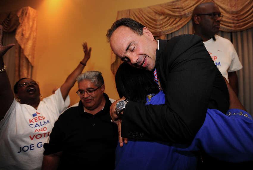 Former Bridgeport Mayor Joseph Ganim hugs Reverend Mary Lee at Testo's Restaurant in Bridgeport, Conn. after winning the Democratic mayoral primary on Wednesday, September 16, 2015.