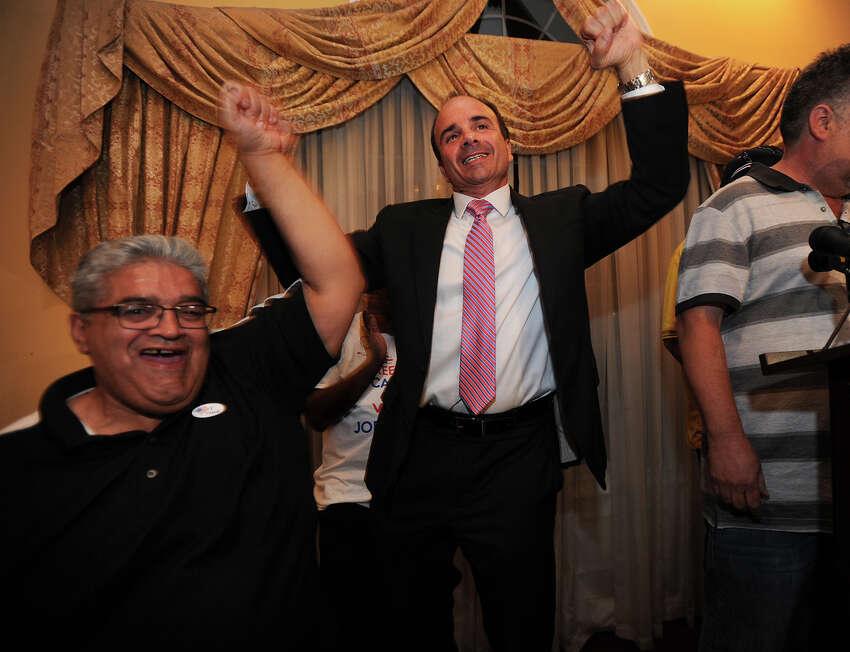 Eddie Moro, left, celebrates with former Bridgeport Mayor Joseph Ganim at Testo's Restaurant in Bridgeport, Conn. after Ganim won the Democratic mayoral primary on Wednesday, September 16, 2015.
