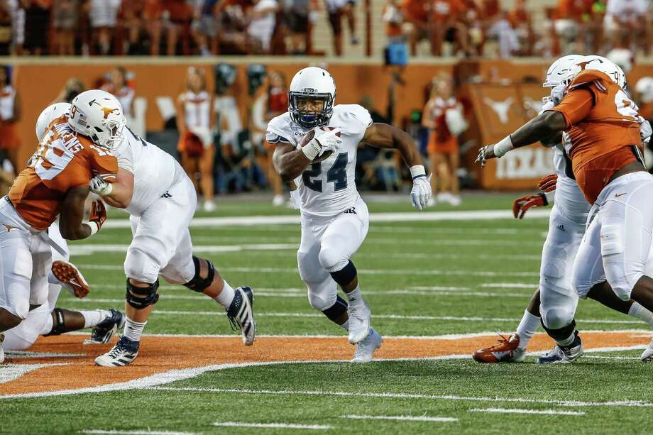With his strong showing against Texas on Saturday, redshirt freshman running back Sam Stewart, right, gives Rice fans a lot to look forward to. He ran for 151 yards and a pair of second-quarter touchdowns. Photo: Carl Henry