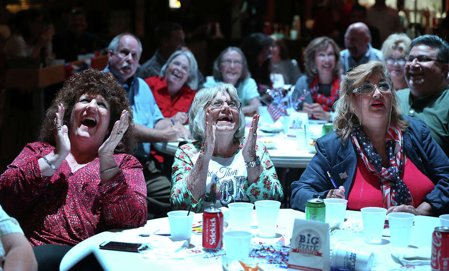Donald Trump's early comments draw laughter from Donna Lee (from left), Tommye White and Margie Harris as a crowd including Christian conservatives at Blue Bonnet Palace watch the second debate for top-tier GOP presidential hopefuls. Photo: Tom Reel / San Antonio Express-News
