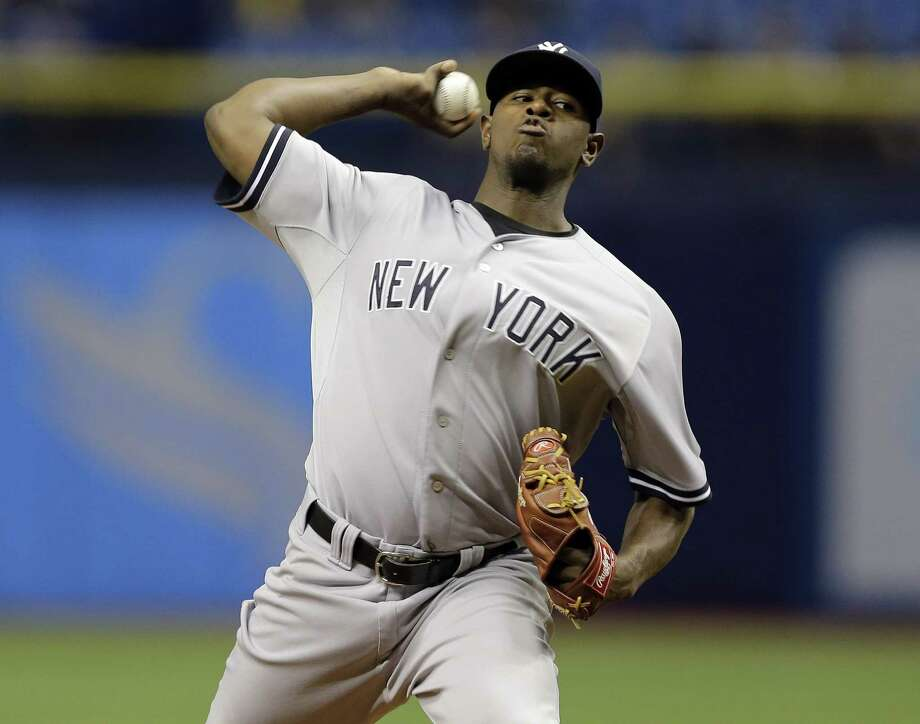 New York Yankees' Luis Severino pitches to the Tampa Bay Rays during the first inning of a baseball game Wednesday, Sept. 16, 2015, in St. Petersburg, Fla.  (AP Photo/Chris O'Meara)  ORG XMIT: SPD102 Photo: Chris O'Meara / AP