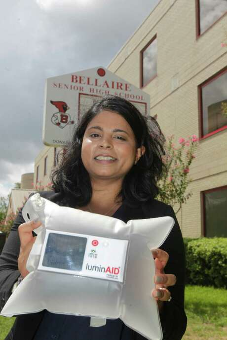 Andrea Sreshta co-founded a start-up business that invented a solar-power light that's collapsible, light-weight and affordable poses for a portrait on Wednesday, Sept. 16, 2015, in Bellaire. Since the creation of that first prototype in 2010, LuminAID lights have now been used in more than 70 countries around the world and in disaster relief aid after Hurricane Sandy, Typhoon Haiyan, and the most recent earthquake in Nepal. That inspired innovation has earned LuminAID a $100,000 Mission Main Street Grant from Chase. ( J. Patric Schneider / For the Chronicle ) Photo: J. Patric Schneider, Freelance / © 2015 Houston Chronicle