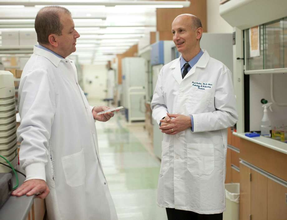 Western Connecticut Health Network doctors, Cristiano Ferlini, left, and Paul Fiedler, are two authors of a new study that links a common virus with most cancers. Photo: Western Connecticut Health Network